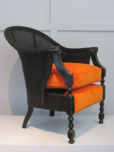 Unusual Lloyd Loom chair, couldn't resist the tango fabric!