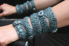 Ravelry: Five Rings pattern by Jana Huck, Steampunk inspired cuffs, uses tensel for shine and a silk/stainless steel blend for glimmer. Then adorn with washers.