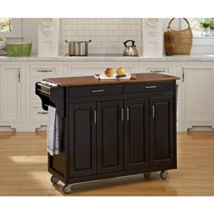 This Mix & Match Create-a-Cart by Home Styles is made of solid wood and will easily store your extra kitchen supplies. The rolling kitchen island cart has four wood framed doors that conceal three storage cabinets with adjustable shelving. Kitchen Island With Granite Top, Rolling Kitchen Island, Kitchen Island On Wheels, Kitchen Island Cart, Granite Tops, Kitchen Cabinets, Black Granite, Kitchen Islands, Island Bench