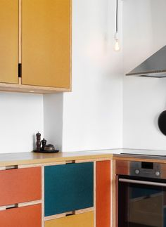 Brighten up a lackluster kitchen by painting cabinets in a variety of color