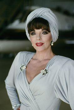 Joan Collins dressed in Nolan Miller .