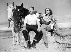 Stellar Vintage #456: Joan Crawford glams up horseback riding gear with a satin blouse, white gloves and round sunnies while out with Franchot Tone in Palm Springs, 1937