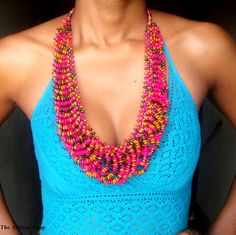 A beautiful handmade beaded Pink and Brown wood necklace.