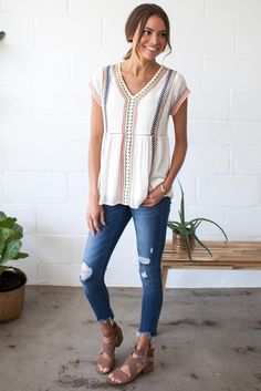 Embroidery is the look of the season, and it's irresistible on this Bohme short-sleeve babydoll top!
