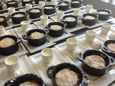 Peach cobblers served in mini cassoulets with creme anglaise.  www.trianglecatering.com
