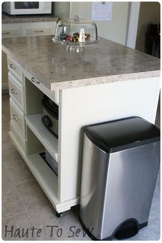 DIY kitchen island from a desk & hutch -   I like the partially open storage here.  This is actually a really good place for the crock pot.