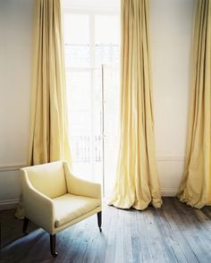 Yellow Curtains - Yellow curtains flanking french doors leading to a balcony