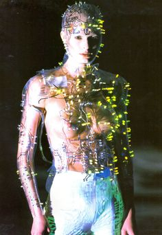 Cyborg. Programmed flashing LEDs mounted on transparent PetG body-hugging bodice , vac-formed from plaster body-cast. Concept by Alexander McQueen . Designed and made by Studio van der Graaf London , for Alexander McQueen at Givenchy Fall/Winter 1999 . #alexandermcqueen2016