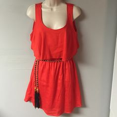 Sleeveless Dress Dress that has belt with end tassels and beautiful opened back! Sits at knee! Made of 100% polyester Dresses Midi