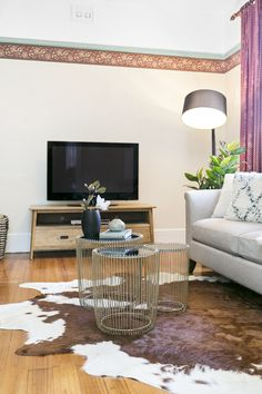 modernised period home, cowhide rug, arc lamp, gold coffee tables, neutral sofas