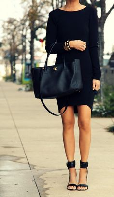 Black mini dress with black leather hand bag and pumps