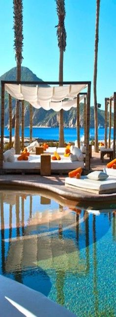 On the finest stretch of beach, as one of the premiere Cabo San Lucas resorts, ME Cabo resort steps down to the sea, its 155 rooms and suites arranged in a terraced embrace of free-form pools and gardens, Bali beds and sunshine. | Honeymoons.com