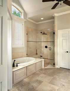 Love the travertine and the panels on the tub. Great shower.  Traditional Bathroom Design, Pictures, Remodel, Decor and Ideas - page 12
