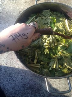Stirring the pot while it cooks down. Note: I wrote the amount of leaves on my hand as not to forget!