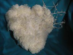 Winter furry valentine of yarn pompoms.