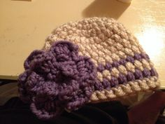 Crocheted hat with flower