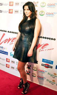 Leather-clad baby bump! Kim Kardashian, who is expecting her first child with boyfriend Kanye West, rocked a sexy black leather dress at Darey's Love Like a Movie concert at the Eko Hotel and Suits Convention Center in Lagos, Nigeria on Sunday, Feb. 17.