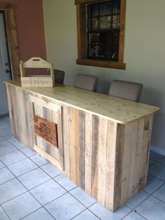 It is a moveable bar of old wooden pallets, the top is made out of white pine with Helmsman spar urethane clear satin.