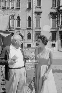 American actress Ruth Roman (Norma Roman) talking to Italian painter Giorgio de Chirico during the XVIII Venice International Film Festival. Venice, 1957