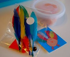 Turkey playdough activity with feathers and googly eyes.