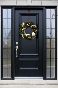 Pictures of Black Front Doors (Front Entry) Here's a truly bespoke black door, with silver hardware, flanked by a pair of smoked glass windows.Here's a truly bespoke black door, with silver hardware, flanked by a pair of smoked glass windows. Front Door Porch, Front Door Entrance, Exterior Front Doors, House Front Door, Glass Front Door, Front Entrances, Front Entry, House Doors, Entry Door With Sidelights
