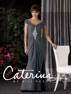 Caterina Collection Style #7018: Shown in Pewter…Figure flattering draped chiffon gown with portrait collar V-neckline. Beaded accent down center front.  Available in sizes 0-34 and petite sizes 0-34.