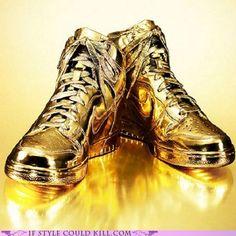 "Nike kicks dunked in 24-karat gold. Aptly named ""INDULGENCES NO. 5″ by designer Kenneth Courtney."