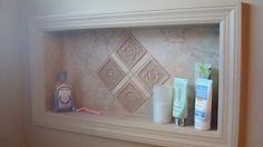 Love the idea of using left over tile and a shadowbox frame minus the glass!