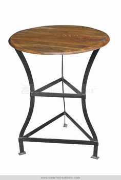 Industrial Iron Round Coffee Tbale The height of industrial chic mixes the warmth of wood with the graphic appeal of weathered iron. This coffee table elevates to reach your garden or living room with ease, and lowers for use at a work or craft table. Whatever your needs, this bar stool will rise to the occasion.http://www.sanchicreations.com/