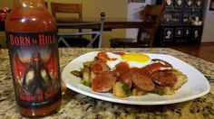 """""""Cajun Hash with Andouille Sausage topped with Born to Hula's awesome """"Reaper of Sorrow"""" Hot Sauce!  A fantastic sauce from one of my favorite hot sauce companies!"""" Thank you @carolinachilehead  for the picture and kind words!"""