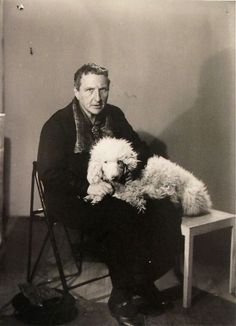 Gertrude Stein and her beloved dog, Basket.  1926. Photographed by Man Ray.