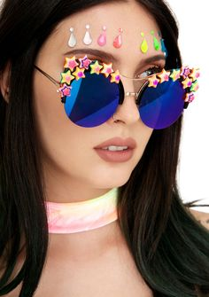 Rad and Refined Bowie Sunglasses are gonna make ya feel like yer floating on stardust. These dope sunglasses feature a cool cat-eye frame that's been embellished with tons of pretty neon stars and round mirrored lenses that shift colors from blue to purple.