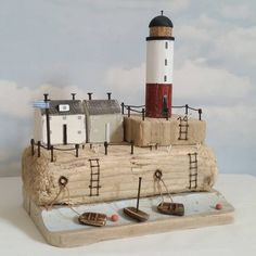 Lighthouse Harbour.  On lovely chunky driftwood, with storm damaged beach hut…