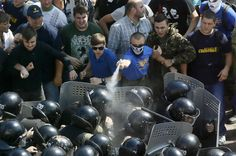 Demonstrators, who are against a constitutional amendment on decentralization, clash with police outside the parliament building in Kiev, Ukraine, August 31, 2015. But many coalition allies, including former prime minister Yulia Tymoshenko, spoke against it and it is open to question whether Poroshenko will be able to whip up the necessary 300 votes for it to get through a second and final reading later this year. REUTERS/Valentyn Ogirenko