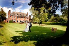 Newlyweds on the lawns - Image Courtesy of Llansantffraed Court www.sachamiller.co.uk