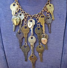 An idea for your upcycled keys! Vintage Key Bib Necklace Constructed with Old Finds ALL KEYED UP  Brass Keys and Charms. $48.00, via Etsy. And you could glitz up the keys.