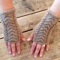 Fingerless mitts are knitted of 100% lambswool.