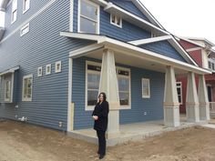 Sarah standing in front of the house before our pre-drywall walk through.  Things are looking pretty good.