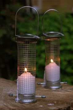 DIY dollar store bird feeders turned into hanging candle holders, cool for out on the patio