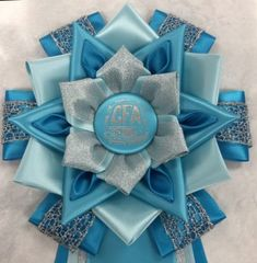 View our collection of ribbons and rosettes available in accents including floral, patterned, glittery golds, silvers and more. Mums The Word, Birthday Pins, Ribbon Rosettes, Dog Show, Corsage, Homecoming, Photo Galleries, Awards, Projects To Try