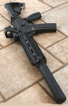 HK 416 with suppressor and EOTECH Find our speedloader now! http://www.amazon.com/shops/raeind