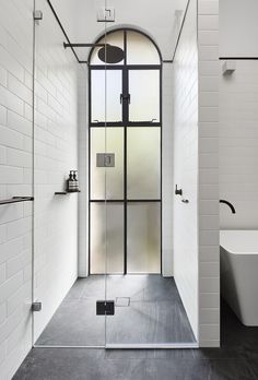 This frosted arch top window creates a bright and open stand up shower. The barrier free shower pan makes entry into the space simple