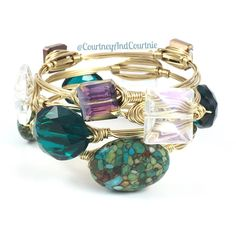 Mosaic Turquoise- can't get enough. Great bangle stack in with a variety of blues and greens! Each bangle in this stack is $15 each or 3/$35!   #wirewrappedbangles #stacks #doyoubangle  #wirejewelry #handmadejewelry  #armcandy #fashion #wraps #druzy #jewelry #bracelets #fashionjewelry #accessories #bangles