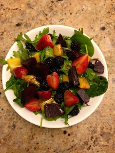Baby spinach & Kale with strawberry, blackberry, beets, yellow pepper and mix of some white truffle balsamic glaze ,olive oil, and balsamic vinaigrette all equal, JUST health