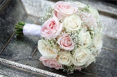Bride's choice of color of roses complimented by fluffy babies breath. Timeless! Wedding Package: $475 CDN Includes: Bride, Groom, 2 Bridesmaids, 2 Groomsmen, 2 Moms pin corsage, 2 Dads. Additional items available.