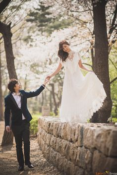 View photos in Korea Cherry Blossoms Pre-Wedding at Yonsei University in Spring. Pre-Wedding photoshoot by Jongjin, wedding photographer in Seoul, Korea. Pre Wedding Shoot Ideas, Pre Wedding Poses, Pre Wedding Photoshoot, Photoshoot Ideas, Wedding Fotos, Wedding Pics, Wedding Couples, Wedding Dresses, Wedding Ceremony