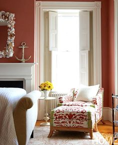 Coastal master bedroom in white and coral with shell decor and anchor on fireplace mantel: http://www.completely-coastal.com/2015/07/traditional-and-modern-nautical.html