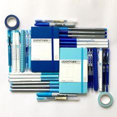 Stationery art; blue flat lay feat. Leuchtturm1917!pens, notebooks, bullet journal side kick, washi tape, pens, zebra mildliner, sharpie, muji, pilot juice, stationery addict. Instagram: Deniz stationerysatellite