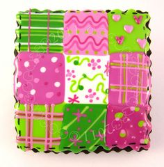 Pink and green cookie made to look like a quilt.
