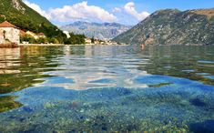 Photo about Photo of Kotor bay with cristal water and a blue sky - Kotor Bay - Montenegro - July 2010. Image of july, cristal, 2010 - 113951986